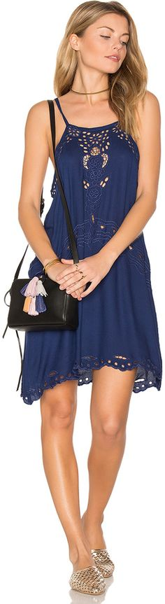 SPRING & SUMMER FASHION TRENDS 2017! TIARE HAWAII JELYS DRESS. Consisting of handmade clothing, sarongs and swimwear, Tiare Hawaii products are inspired by a life of travel and the ocean. Beautiful lightweight navy dress with scalloped hem and embroidered eyelet detail throughout. Unlined (affiliate)