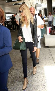 Rosie Huntington-Whiteley // leather jacket, white tee, Saint Laurent bag, black jeans & python boots #style #fashion #model #airport #celebrity