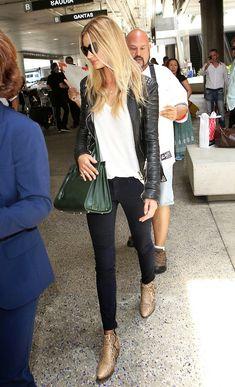 leather jacket, white tee, Saint Laurent bag, black jeans & python boots. Rosie