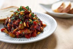 Tricks for making a simple Caponata with creamy eggplant, briny green olives & capers, crisp celery, sweet raisins and earthy pine nuts.