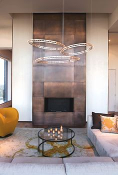 A fireplace highlighted with copper panels for safety and a bold modern look. texturadas sala How To Expand Living Room With Fireplace With Copper Panels texturadas interior Metal Fireplace, Luxury Living Room, Home Fireplace, Living Room With Fireplace, Fireplace Design, Home Decor, House Interior, Modern Fireplace, Interior Design