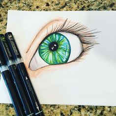 @savannahgordon0203 their amazing close up illustration of a green and blue eye.