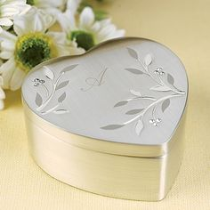 Diamond Vines Jewelry Box A brushed silver, Heart shaped jewelry box with vine design and rhinestone accents. Ideal for bridesmaids
