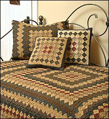The Trip Around the World tea-dyed quilt has tiny square patches of beige, rust red, blue, olive green and black. The pattern is also available in pillow shams, dust ruffle, throw and more. Order these items at www.choicesquilts.com. See more country products in the March issue of Country Sampler: http://www.samplermagazines.com/February_March_2014_Country_Sampler_Pre_sale_p/c314b001a.htm