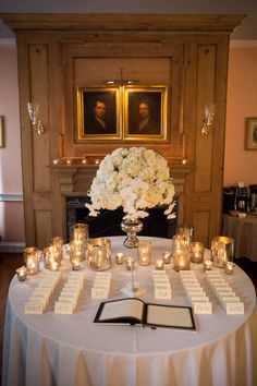 Love these silver candles on the escort table.....now with a different arrangement ....perfect :)