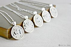 Bridesmaid necklace gift set made with vintage sheet music.  Wrapped in your wedding colors and ready to give!