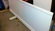 Need to do this - Took two panels of wainscoting from Lowes, a chair rail, and baseboard. (And some wood for a frame and liquid nails) I can easily change the top color of the backdrop in the studio. Cost was around $30