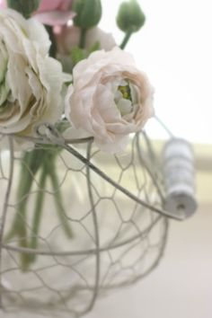.roses, roses roses & love the chickenwire basket such a contrast.....makes a statement