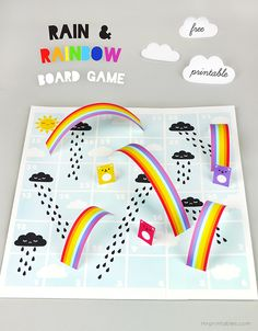 Rain & Rainbow Board Game - a variation of Snakes & Ladders. Free printable!