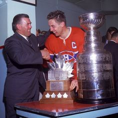 From the Archives - Jean Beliveau & Maurice Richard celebrate the Canadiens 1965 Stanley Cup championship. @CanadiensMTL