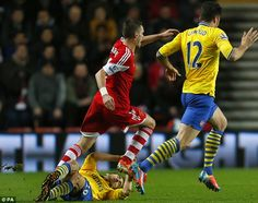 Southampton 2 Arsenal 2 : Mathieu Flamini goes in two footed on Southampton's Morgan Schneiderlin, and receives a red card.