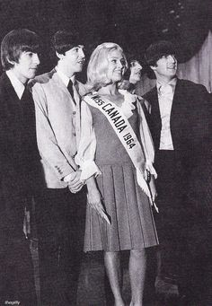 The Beatles with Miss Canada 1964, Carol Ann Balmer, at a Toronto press conference, 7 September 1964. Photo by Curt Gunther.