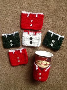 Christmas vest mug cosy's, with vintage Mother of Pearl buttons..?I made these last December, 2014...photo by B. Wittig