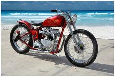 candy apple red Triumph bobber at the beach – MotoZania the motorcycle network Triumph Chopper, Triumph Bobber, Bobber Motorcycle, Bobber Chopper, Triumph Motorcycles, British Motorcycles, Vintage Motorcycles, Custom Motorcycles, Custom Bikes