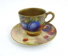 Lot: A Royal Worcester demi-tasse cup and saucer, with, Lot Number: 0472, Starting Bid: £80, Auctioneer: Dickins Auctioneers Ltd, Auction: Antiques & Collectables ( 2-day Auction) , Date: December 30th, 2017 EST