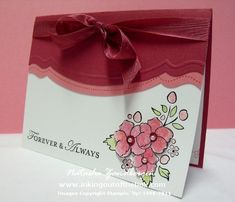 Stamps – Bordering on Romance, Loving Thoughts    Ink & Paper – Rose Red, Regal Rose, Whisper White, Pear Pizzazz, Stazon Black    Accessories – Big Shot and Adorning Accents Edgelits die, Rose Red seam binding, pearl accents, Dazzling Details
