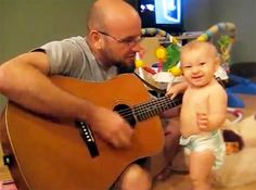 You will love this Rock-N-Roll baby!!  Awesome Baby Rocks Out Alongside Daddy - Soooo Sweet!