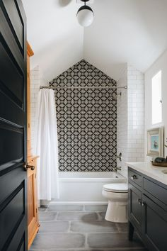 Bathroom Decor black and white black and white bathroom // black vanity // black and white pattern tile shower // vaulted ceiling // white subway tile Bathroom Lighting Design, Bathroom Light Fixtures, Plumbing Fixtures, Interior Lighting, Bad Inspiration, Bathroom Inspiration, Interior Inspiration, White Bathroom, Bathroom Interior