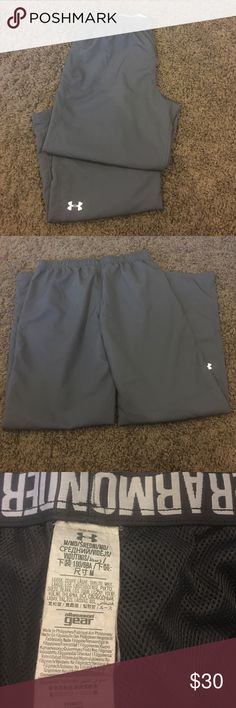 Under Armour wind breaker pants Worn a handful of times, still in great condition with tons of life left in them! Size M. Bootcut style bottoms, pockets on both sides. Inseam is 31 inches. Under Armour Pants Track Pants & Joggers