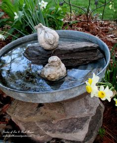 Stacked Stone Bird Bath. Thinking of making one of these fr. a metal garbage can cover!