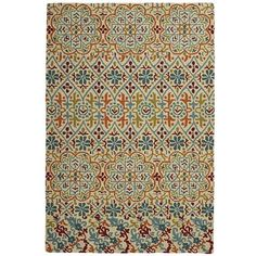 Calla Mosaic Rugs. Polyester.  5x8 is $325.  Dark brown sofa would not exactly match, but is cheerful and easy to clean...