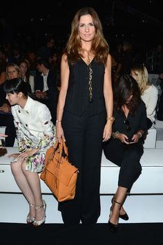 Livia Firth - Gucci Front Row #mfw the pop of color in the bag shows she might not suck your blood...