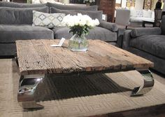 grey couches, rustic table