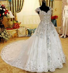This needs lace sleeves, and a more cut bodice and it would seal the deal.   Wholesale Zuhair Murad Vintage Ball Gown Sweetheart Swarvoski Crystal Rihnestones Train Wedding Prom Dresses, Free shipping, $425.6-515.2/Piece   DHgate