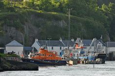 A view from the Islay ferry arriving in Port Askaig in June 2014. On the left the RNLI lifeboat ready for its next call out, on the right the Jura ferry waiting for passengers. The new RNLI station...