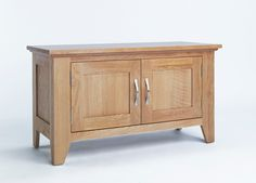 Sherwood Oak Cabinet 2 Door - The Sherwood Oak range is made of a high quality grade of oak and exhibits all the hallmarks of quality furniture.These include wood-panelled drawer bases and cabinet backs and the use of dovetailed joints in constructing drawers.
