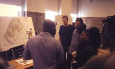 KEA students at #KEAweekAfrica showing delegation from Plan Zimbabwe and Denmark their post-slum urban plan.