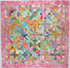 The woman who made this quilt calls it a Japanese x and + quilt. This so adorable! I don't usually like a lot of pink in my quilts, but it goes well with all the tropical colors.