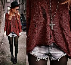 I love this look with the ripped shorts, black tights, and huge sweater.