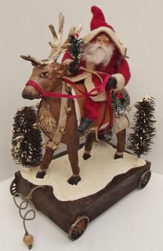 Handmade Santa Claus riding a hand sculpt Reindeer Pull Toy By Kim Sweet~Kim's Klaus
