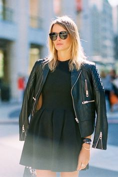 Mix and match ladylike and rocker pieces in your closet like this Parisian woman.  Her flared black elegant dress is juxtaposed by the grungy and masculine type leather jacket.  I think this outfit works, and I definitely need to try this looks over the holidays.