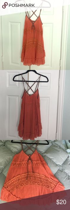 Strappy Top Orange strappy top with lace up detailing and criss cross straps in back. Altar'd State Tops Tank Tops