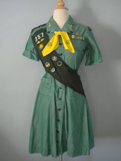 vintage girl scout uniform; If I found this somewhere, I'd pair it with a cute skinny Leather belt, some sandals, rolled up Jean jacket and call it an outfit; minus the sash. :)