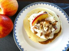Pancakes served with low fat Greek yoghurt, grated apples and hazelnuts