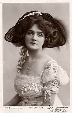 Vintage photo - beautiful young woman with an extraordinary dress.