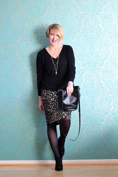 A fashion blog for women over 40 and mature women  Sweater: Neyo-Fashion Skirt: Norma Kamali Bag: Marc Jacobs Booties: Anine Bing