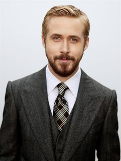 Ryan Gosling shows everyone how a man should dress. No woman is gonna complain about the facial hair either.
