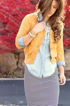 Cardigan over button down chambray with a striped skirt for fall layering