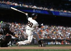 Buster Posey hits a sacrifice fly in the seventh inning.