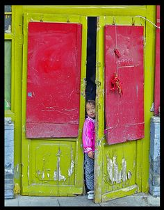 Inner Mongolia... I love the colors, and the little girl peeking out.