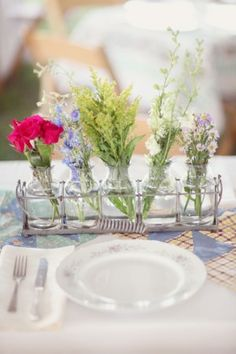 This is easy and adorable.  Mix and match your plates and the bottles.  Add some high and low for interest.