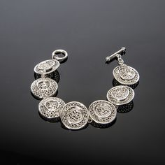 Our sterling silver moonlight bracelet will glow and illuminate any outfit as it gently dangles from your wrist.