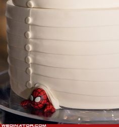 Have something of the grooms likes or hobby peeking out from bottom of cake on one side