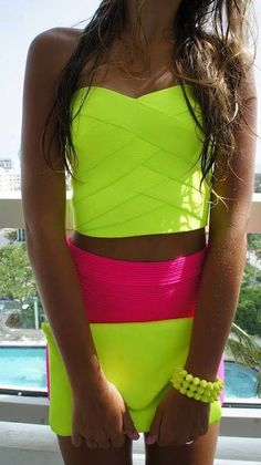 Neon colors are in right now. Also the short tops are in style. This whole outfit lights up with her tan. neon  #neon ☮k☮
