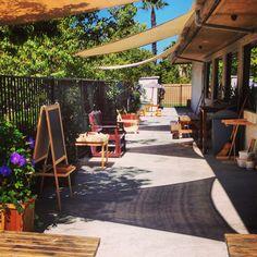 Outdoor work area for gardening, painting & exploration at Mission Montessori. Montessorimv.com