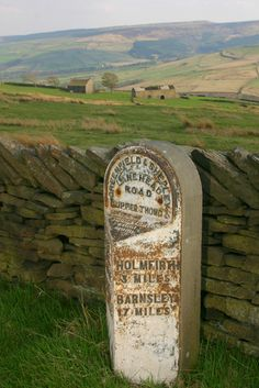 Yorkshire Moors. A sign stating three miles to see Compo...
